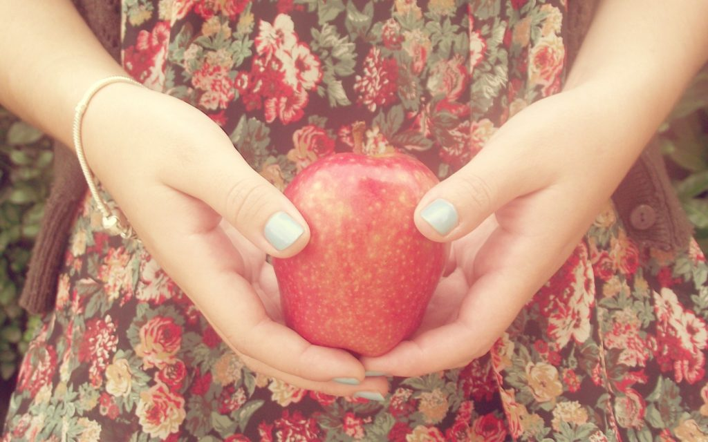 7039689-girl-hands-apple